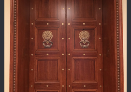Elevator doors with woodgrained finish and Trompe L'oeil panels.